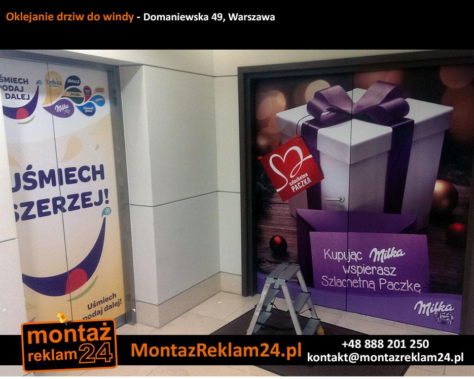 Oklejanie drziw do windy - Domaniewska 49, Warszawa.jpg