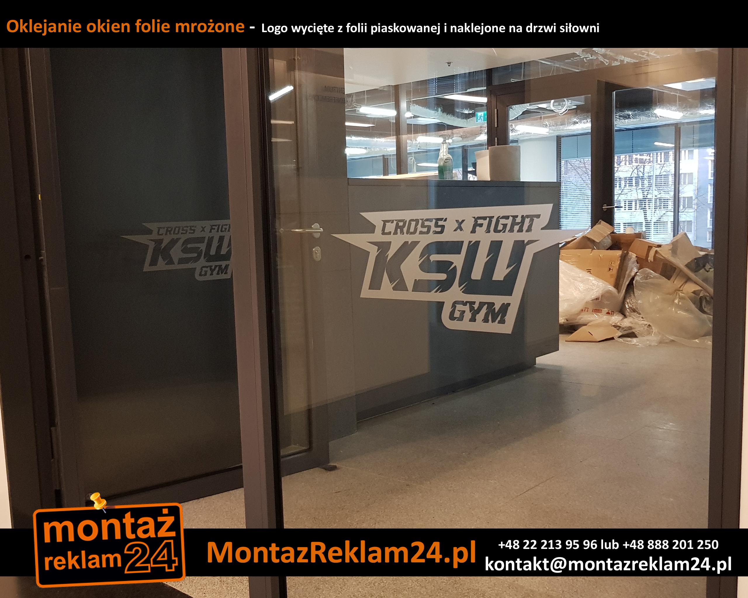 Oklejanie okien folie mrożone -  Logo wycięte z folii piaskowanej i naklejone na drzwi siłowni.jpg